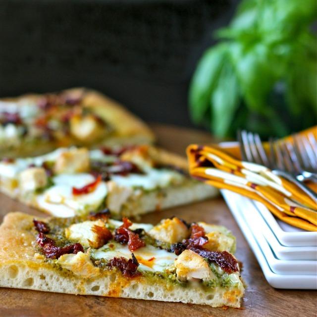 pesto pizza with chicken, mozzarella, and sun-dried tomatoes